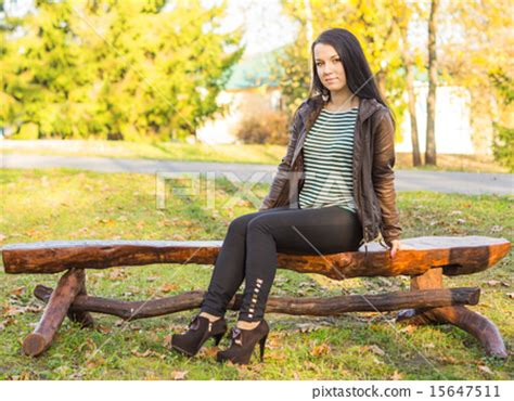 girl sitting on bench beautiful and sexy girl sitting on bench outdoors stock photo 15647511 pixta