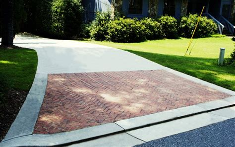 a great way to dress up a concrete driveway is the