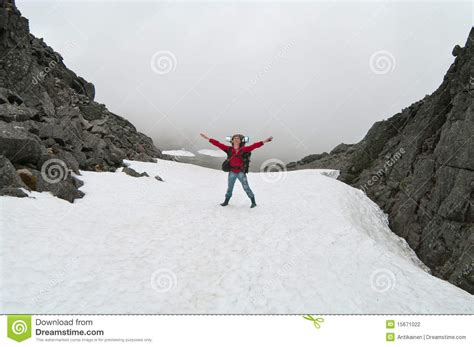 man standing on mountain top man standing on top of mountain stock photography image