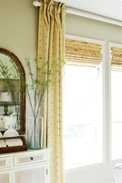 woven shades with curtains bamboo roman shades in the family room at the picket fence