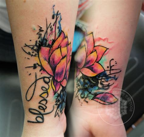 logan tattoo absolutely this watercolor lotus coverup by