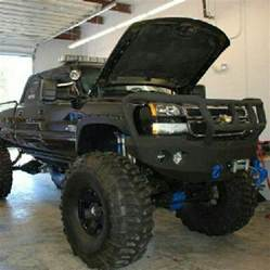 chevy road bumper jacked up truck