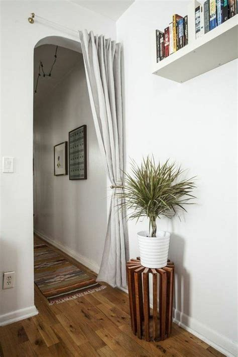 hanging curtains in an apartment doable decorating ideas to steal for your first apartment curtains first apartment and