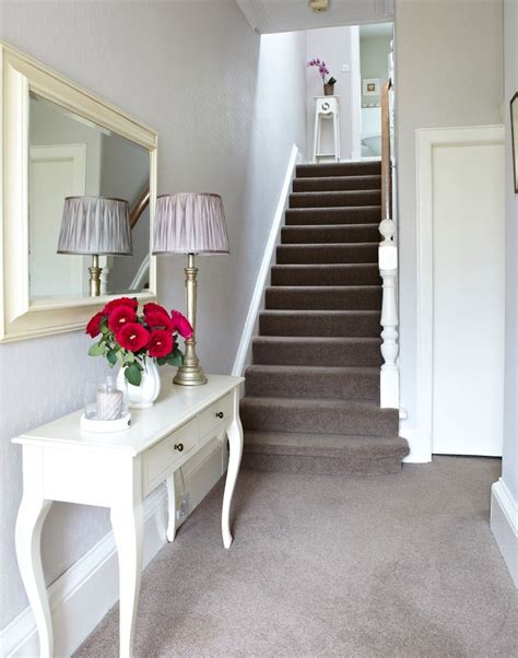 carpet for hallways and stairs white traditional hallway with taupe carpet and