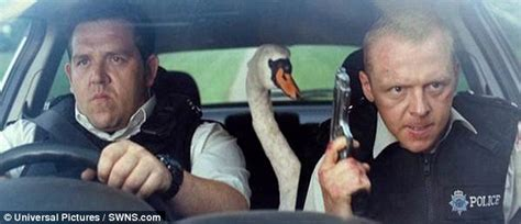 funny movies like hot fuzz wiltshire police pose with a swan like the hot fuzz scene