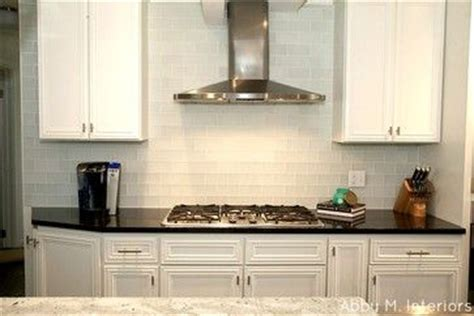 frosted white glass subway tile transitional kitchen