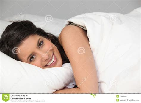 Young Woman Smiling Laid In Bed Royalty Free Stock Images Image 17825309