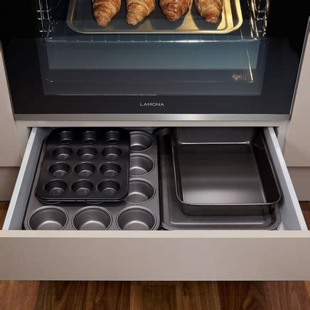 bottom drawer on oven purpose built oven housing with shallow storage drawer