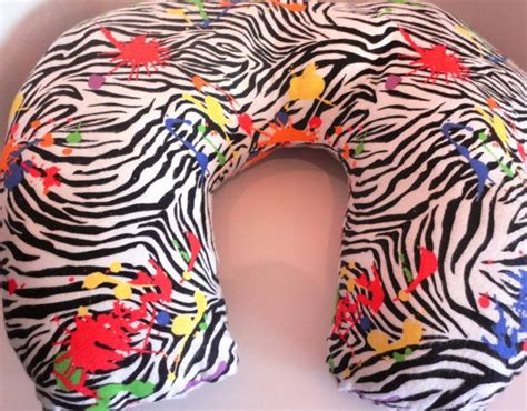 zebra animal print with splatter paint design baby moon boppy pillow