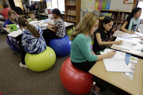 ball to sit on at desk pennsylvania swaps desks for yoga balls to help
