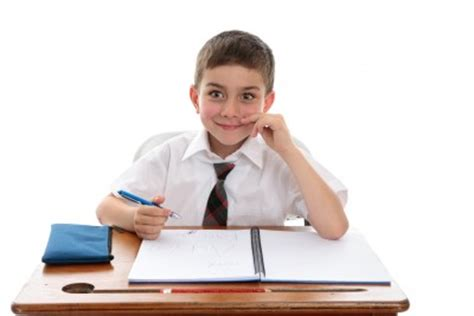 student at a desk set up structured morning activities autism educates