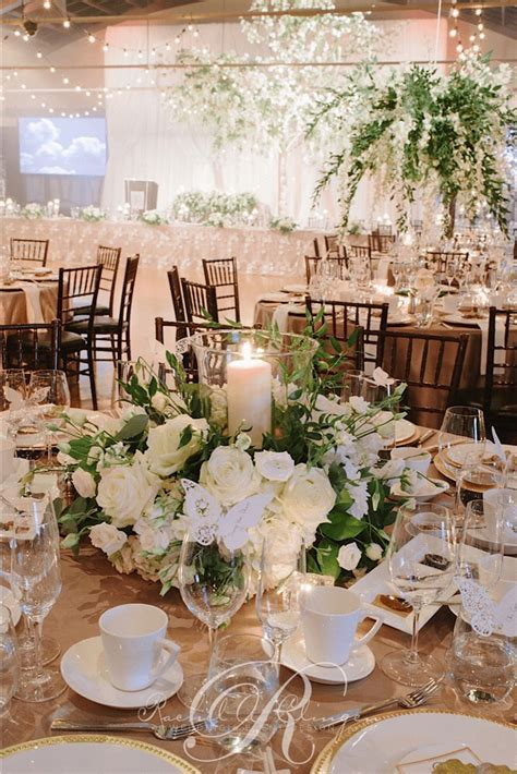 Love this centerpiece with hurricane lamp   Reception