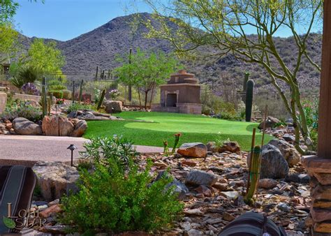 desert landscape with artificial turf putting green and