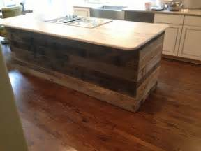 Tongue and groove reclaimed barnwood on a kitchen island image by