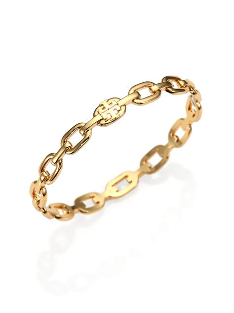 burch logo chain bangle bracelet in gold lyst