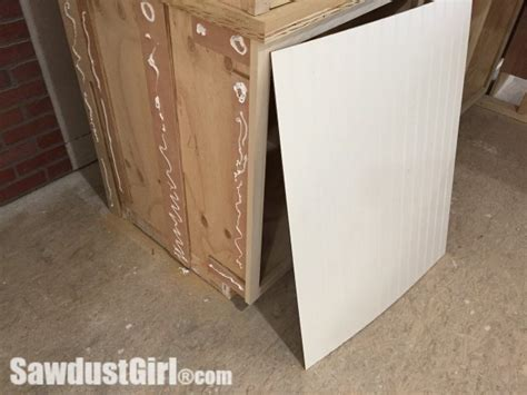 adding bead board to sides of cabinets to cover up sides add beadboard paneling to cabinet sides sawdust girl 174