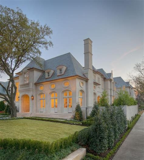 french chateau style home in stucco cast stone