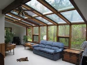 This open concept solarium features wood interior beams with a