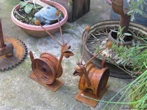 garden made from junk garden snails made from junk yard