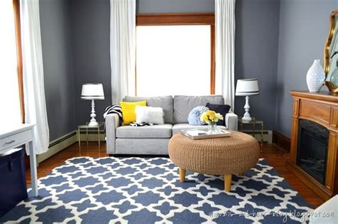 den with wood trim and hardwood floors walls painted blue grey graphic blue rug and light grey