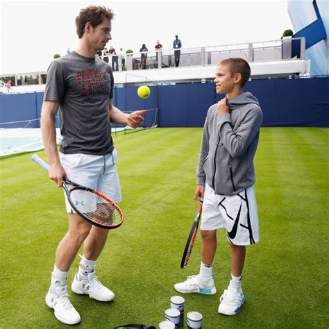 romeo beckham speaking romeo beckham excitedly watches the tennis with david