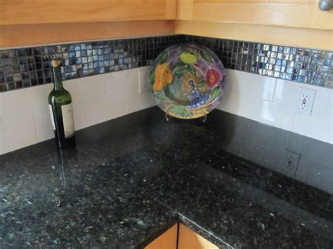 uba tuba granite counter top w glass mosaic and subway