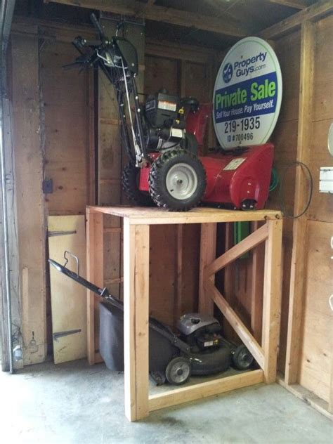 Hang Lawn Mower In Garage by Depending On The Season Stack Your Snow Blower Or Lawn