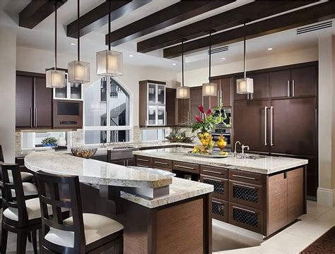 Two Kitchen Islands Medium Sized Kitchen With Two Islands One Island Is 2 Levels For An Elevated Eat In Counter