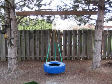 hanging a swing between two trees tire swing between two trees backyard fun pinterest