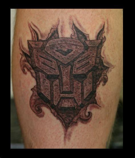 cross tattoo ripping out of skin mystic art tattoo tom milhoan