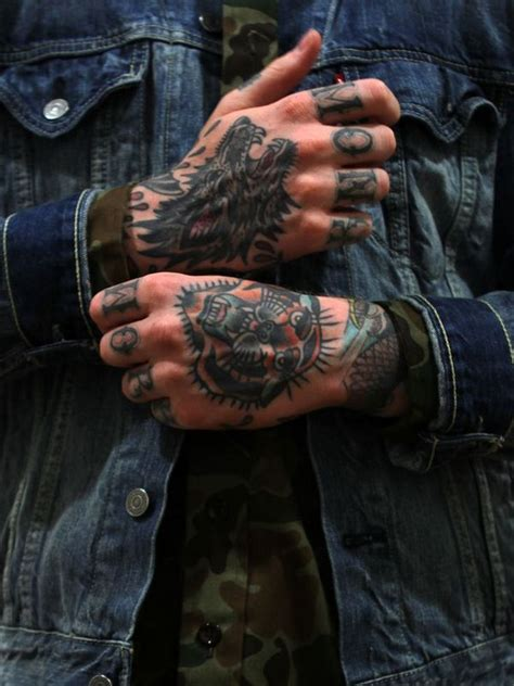 tattoo down finger 55 powerful hand tattoo designs