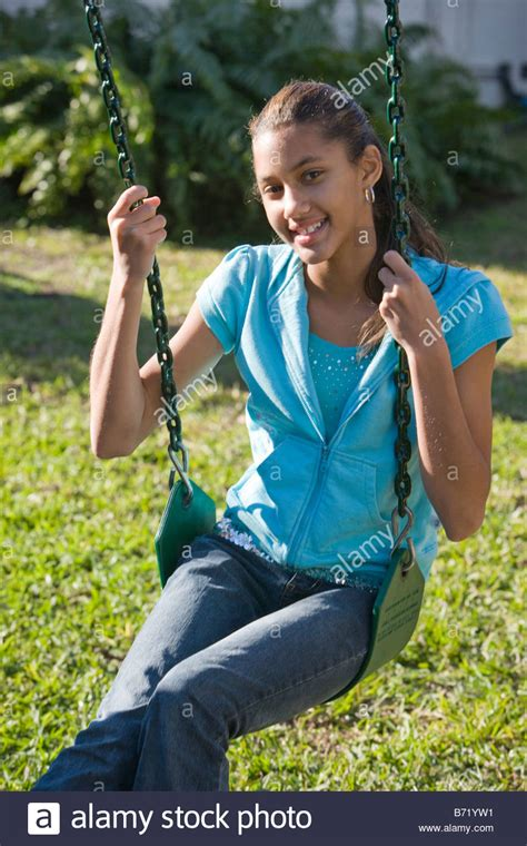 backyard babes happy african american pre teen girl sitting on swing in