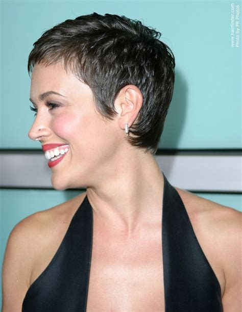 3 hairstyles to show off this season s statement earrings alyssa milano short and simple pixie cut to show off