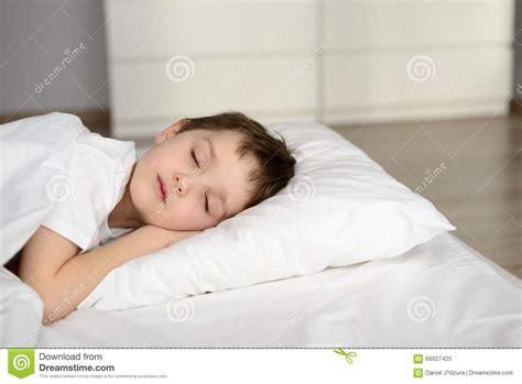sleepy bed tired kid sleeping in bed happy bedtime in white bedroom