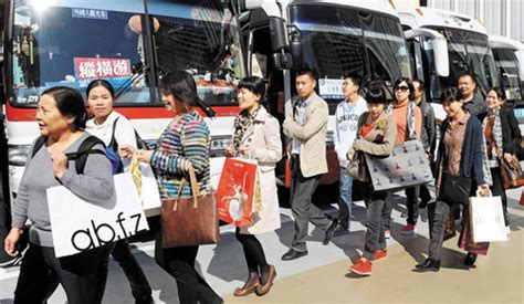 still ravenous for designer brands chinese tourists proving savvy shoppers the