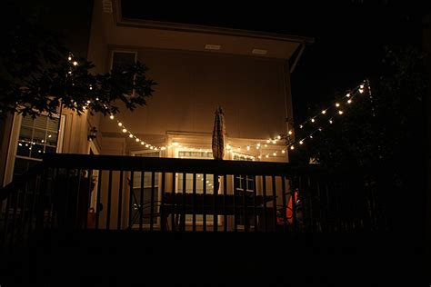 string lights on deck railing thrifty thursday how to hang string lights the deck