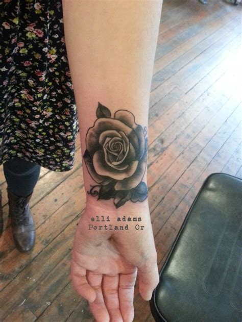 black rose tattoo parlor cover up black and grey on a wrist icon