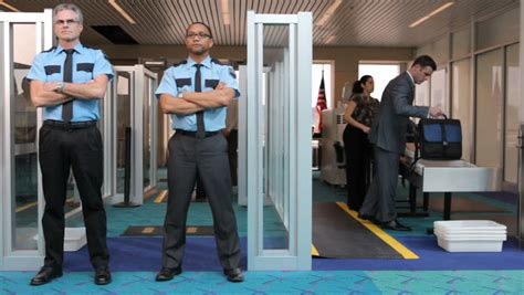 The View Discuss Airport Security by Airport Security Guard Stands At Metal Detector