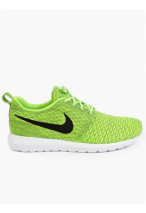 green sneakers nike nike men s flyknit roshe run sneakers in green for lyst