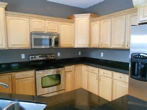Kitchens with gray granite counter tops and cream brick kitchen wall