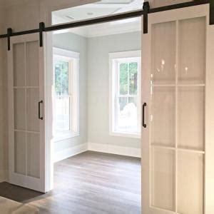 pocket door alternatives alternative to pocket doors a barn door like this because the hardware is covered good idea