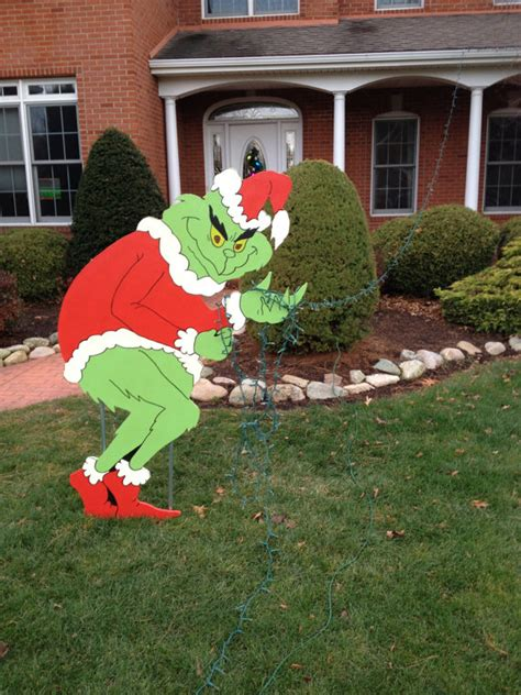 grinch stealing christmas lights yard art decoration grinch