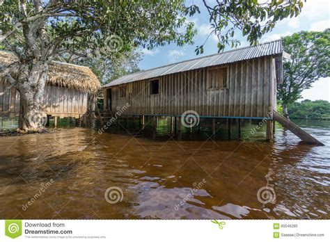 house over water woode houses built on high stilts over water amazon