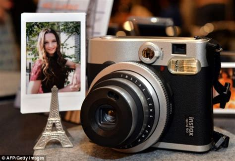 that prints photos instantly return of the polaroid fujifilm resurrects iconic