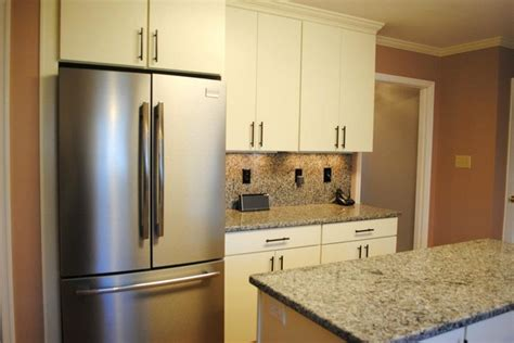 white quot rohe quot cabinets stainless appliances kitchen