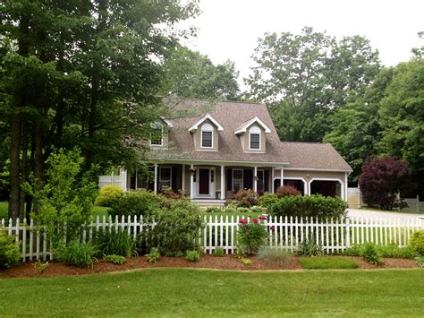 the picket house living the american dream with a white picket fence