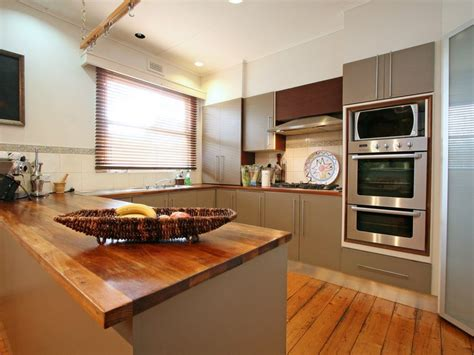 kitchen u shape designs modern u shaped kitchen design using floorboards kitchen photo 480371