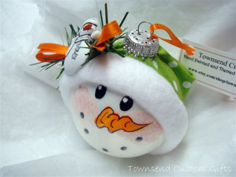 snowman ornament christmas tree bulb hand from