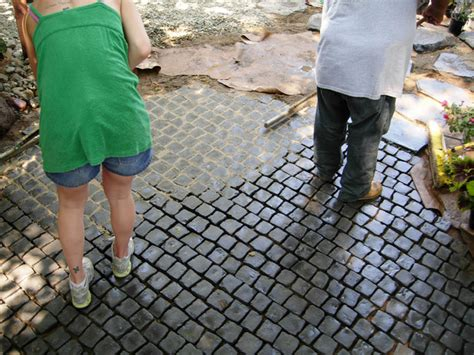how to install a cobblestone patio on concrete or bare