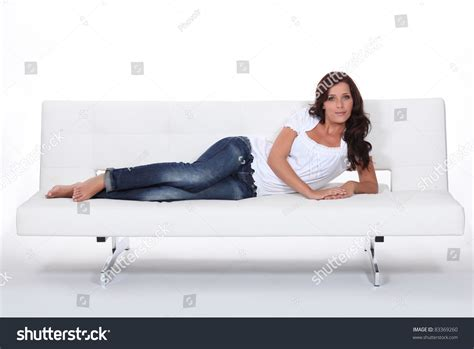 lying on a sofa woman lying on a couch stock photo 83369260 shutterstock